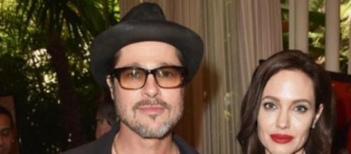 Angelina Jolie e Brad Pitt (foto cover media)