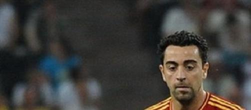 Xavi Hernández en un partido de Selección