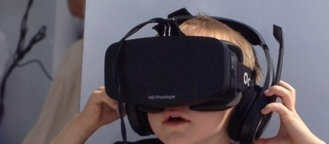 Boy wearing a prototype of Oculus Rift.