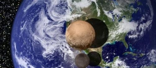 Plutone e Caronte, Foto dal sito Nasa