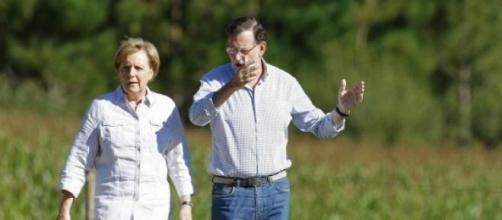 Merkel y Rajoy durante el camino de Santiago