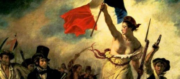 Emblema da Liberdade empunhando o símbolo pátrio.