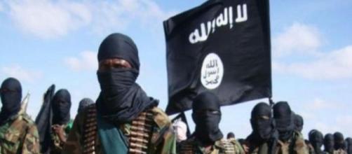 jihadisti dell' ISIS come banditi a volto coperto