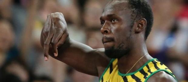 Usain Bolt is gold in 100m race.