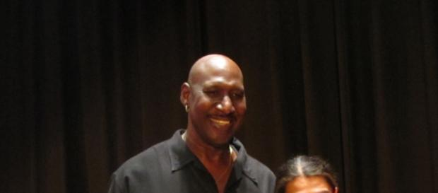 Darryl Dawkins standing with a fan
