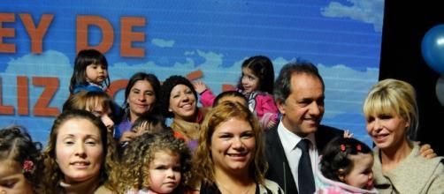 Scioli junto con su esposa y familias