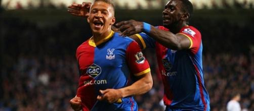 Dwight Gayle celebrating with Yannick Bolasie
