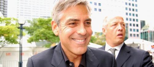 George Clooney arrives at TIFF - Courtney csztova