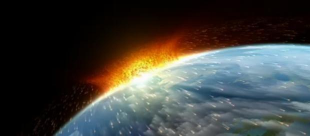 Ilustración de un meteorito impactando la tierra