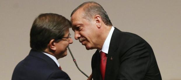 Turkey PM Ahmet Davutoglu (left) and Erdogan