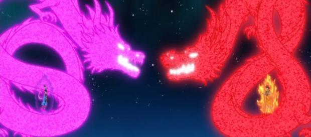 Bills y Goku elevando su ki con proyecciones