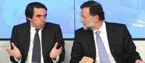 Aznar y Rajoy en un acto del PP