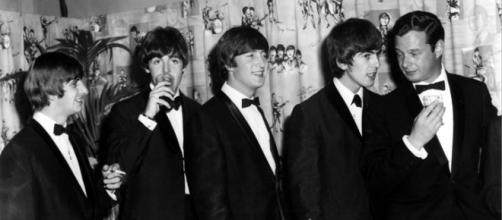I Beatles con il manager Brian Epstein