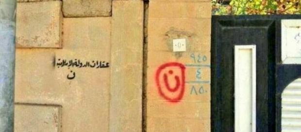 Chrześcijański dom oznaczony arabską literą nun