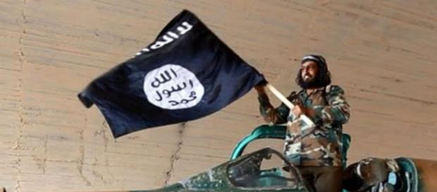 Flag of ISIS and ISIS fighter (Google photo)