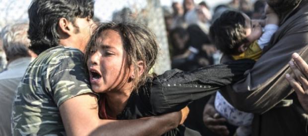 Refugiados sirios huyendo del Estado Islamico