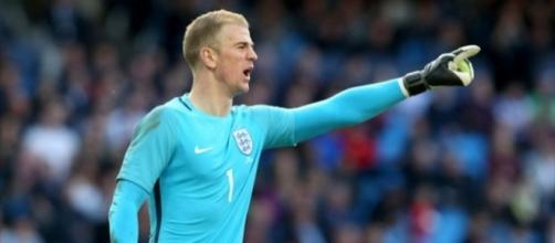 Joe Hart showed the way to get a hard-earned point in Slovenia.