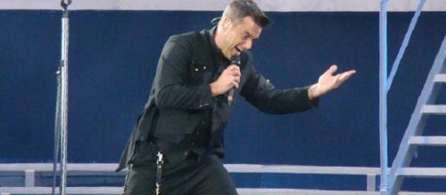 Robbie Williams loves being on stage