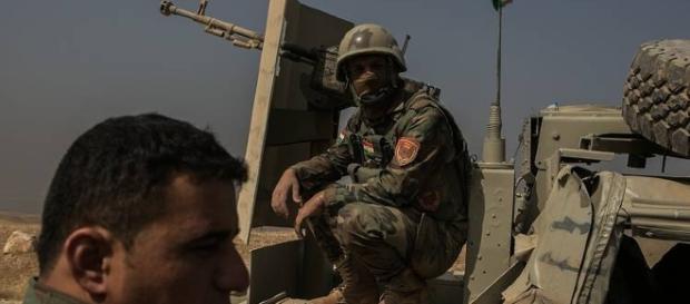 Kurdish Peshmerga troops awaiting battle/Photo via Wall Street Journal