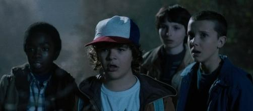Millie Bobby Brown, Finn Wolfhard, Gaten Matarazzo, Caleb McLaughlin in Stranger Things | Courtesy of Netflix (netflix.com - used with permission)