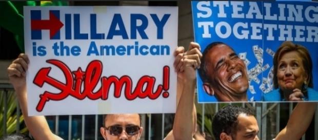 Em cartaz, manifestante diz que Hillary é a Dilma americana