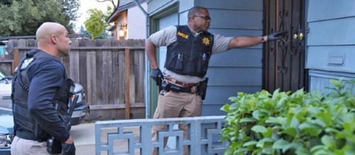 Parole agents conducting Halloween check of sex offender's home. (File Photo provided by, used with consent of California Dept. of Corrections)