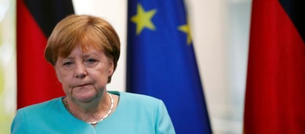 Shell-shocked German Chancellor calls for calm as far-right ... - thesun.co.uk