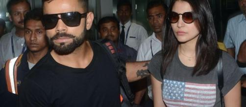 Virat Kohli and Anushka at the airport. -panasiabiz.com