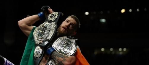 Conor McGregor makes history at UFC 205 after becoming first dual ... - georgianewsday.com