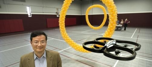 Professor Bin He in working on brain-controlled robots. (Photo via Phys.org)