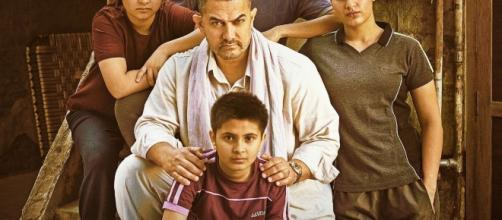A still from Dangal featuring lead cast in the film ( Source :twitter/taran_adarsh)