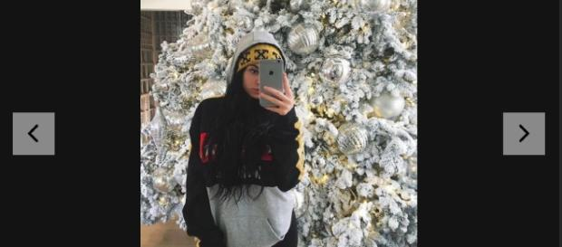 Kylie via Cosmopolitan.com: http://www.cosmopolitan.com/entertainment/a8502109/kylie-jenner-and-tyga-christmas-tree/