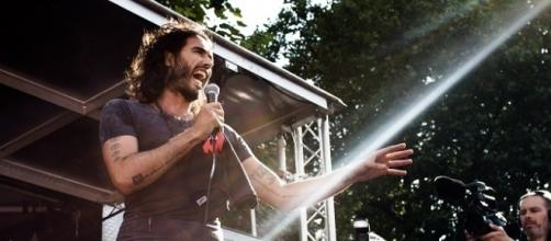 Source: Wikimedia DB Young: Russell Brand speaking at rally