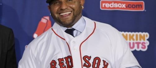 In this photo from 2014, Pablo Sandoval beams as contract with Boston Red Sox is announced. - sfgate.com