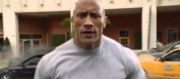 The Rock put on his swimming shorts. / youtube