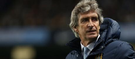 Pellegrini lifted League Cup with City