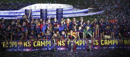 Imagen del FC Barcelona celebrando el triplete