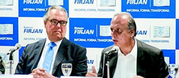 Presidente do Firjan ao lado de Pezão.