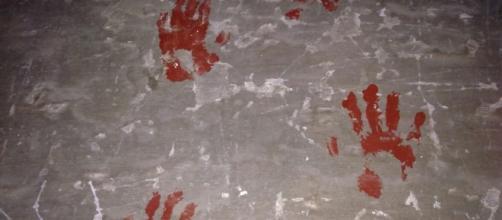 Manos pintadas en la casa de las Sogas