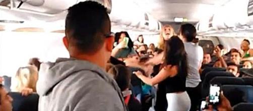 Flight attendant breaks fight [Image via YouTube]