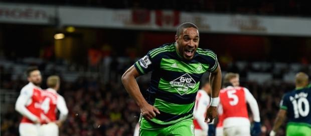 Ashley Williams celebrates his 74th minute winner