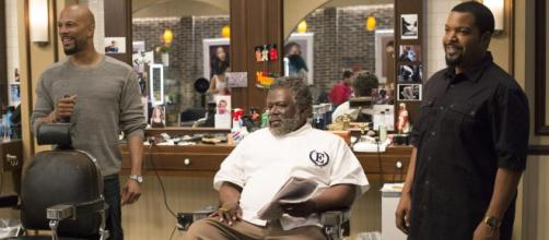 Rashad (Common), Eddie (Cedric the Entertainer) and Calvin (Ice Cube) hold court in Barbershop: The Next Cut. Courtesy Warner Brothers