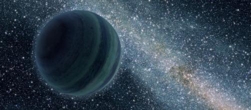 Interpretación artística de un planeta nómada dentro de la Vía Láctea