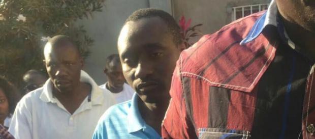 NIA Agent Gomez seen here in the midst of protesters in a sky blue shirt / Fatu Camara, The Fatu Network