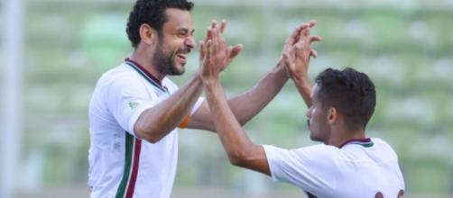 Com Gustavo Scarpa, Fred comemora gol da vitória sobre o América/MG (Fonte: Lancepress)