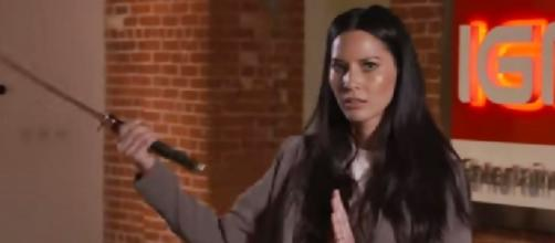 Olivia Munn shows IGN sword skills / screencap, via YouTube