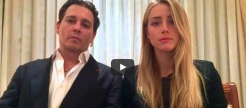Depp and Heard in their infamous apology video / by screencap, YouTube