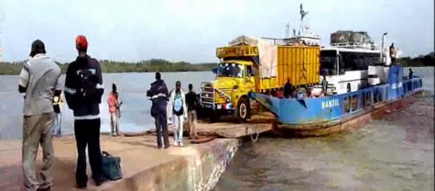 Comemrcial Senegalese truck carrying good on a ferry at Bambatenda-Yellitenda Ferry crossing / Sam Phatey, SMBC NEWS