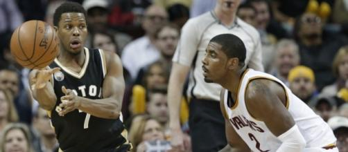 Toronto Raptors' Kyle Lowry (7) passes against Cleveland Cavaliers' Kyrie Irving - AP PHOTO/TONY DEJAK
