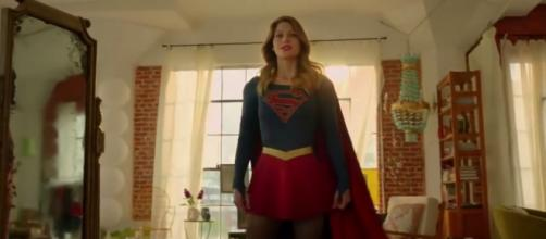 Supergirl in her uniform for the first time (Via Youtube)